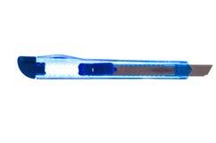 Couteau bleu de papeterie sur un fond blanc Photo stock