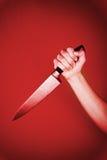 Couteau dans la main Image stock