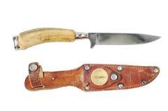 Couteau de chasse de cru avec un os Photo stock