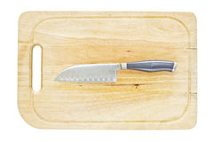 Couteau de cuisine sur une plaque de découpage Images libres de droits
