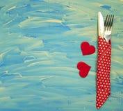 Couteau de fourchette, fond bleu, coeur février Photos libres de droits
