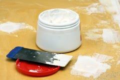 Couteau de mastic avec la pâte Photos libres de droits