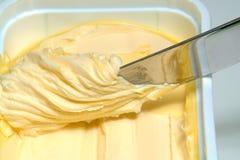 Couteau et beurre Photos stock