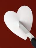 Couteau et coeur Images stock