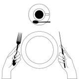 Couteau et fourchette dans des mains d'isolement sur le blanc Image libre de droits
