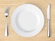 Couteau et fourchette sur la table Image libre de droits