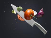 Couteau et légumes Photo stock