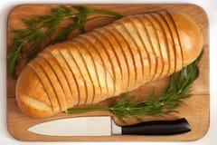 Couteau et pain sur un panneau Image libre de droits