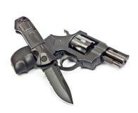 Couteau et revolver Photos libres de droits