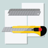 Couteau jaune de papeterie Photo stock