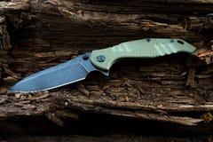 Couteau militaire avec la poignée de greenn Photo stock