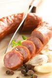 Couteau, saucisse et poivre Photos stock