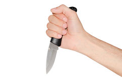 Couteau se pliant dans la main d'un homme. photographie stock libre de droits