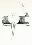 Couteau suisse et clé Images libres de droits