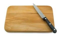 Couteau sur le panneau de découpage Images stock