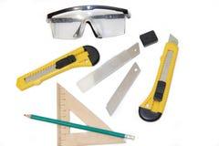 Couteaux de construction sur les outils blancs d'un fond sur un fond blanc Articles pour la réparation et la collection de meuble image libre de droits
