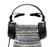 Écouteurs avec du CD Photos stock