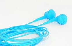 Écouteurs bleus Photos stock