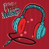 Écouteurs bleus sur un fond rouge Photo stock