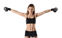 Coutout confident sportswoman lifts dumbbells for training deltoid muscles Stock Photography