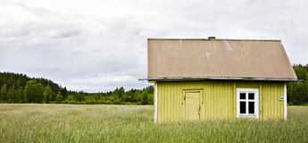 Coutry house. Abandoned house in the middle of a field in finland royalty free stock image
