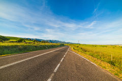 Coutry road under a blue sky in Sardinia Royalty Free Stock Photography