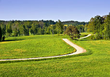 Coutryside landscape with a winding road. Royalty Free Stock Photos