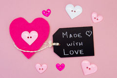 Couture - faite avec amour avec des boutons Photographie stock