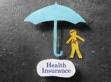 Couvert par assurance médicale maladie Photos stock