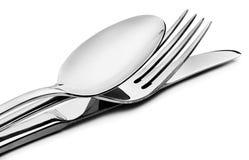Couverts - une cuillère, une fourchette et un couteau Photo stock