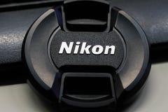 Couverture d'objectif de caméra de Nikon images stock
