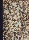 Couverture de livre marbrée par antiquité photos stock