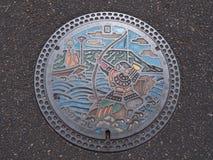 Couverture de trou d'homme à Takamatsu, Kagawa, Japon Photographie stock
