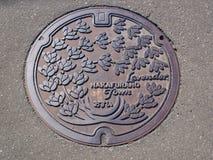 Couverture de trou d'homme au Hokkaido, Japon Photo libre de droits