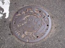 Couverture de trou d'homme au Hokkaido, Japon Image libre de droits