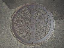 Couverture de trou d'homme dans Funaoka, Japon photographie stock libre de droits