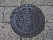 Couverture de trou d'homme de Yokohama, Japon Photographie stock