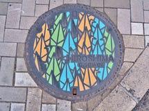 couverture de trou d'homme d'Hiroshima, Japon Image stock
