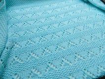 Couverture tricotée par turquoise Image stock