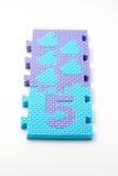 Couvre-tapis de puzzle du numéro cinq. Orientation sur le plan (petit DOF) Images stock