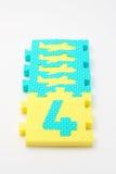 Couvre-tapis de puzzle du numéro quatre. Orientation sur le plan (petit DOF) Photographie stock libre de droits