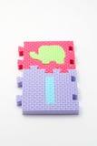 Couvre-tapis de puzzle du numéro un. Orientation sur le plan (petit DOF) Photo libre de droits