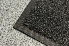 Couvre-tapis industriel de la poussière images libres de droits