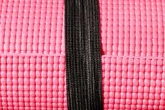 Couvre-tapis rose de yoga Photographie stock