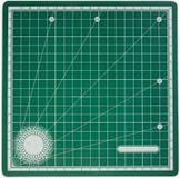 Couvre-tapis vert de découpage Photos libres de droits