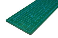 Couvre-tapis vert de découpage Photo stock