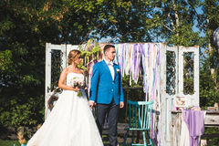 Couyple at Decorated Gates. Couple standing at decorated gates at yard Stock Photography