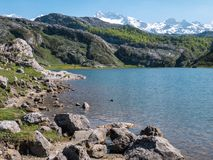 Ercina lake and mountain peaks covered with the snow. Stock Images