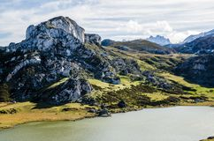 Covadonga lakes, Picos de Europa. Asturias, Spain. Covadonga lakes, Picos de Europa. Rocks, mountains and water landscape in Asturias, Spain in a sunny day on royalty free stock photography