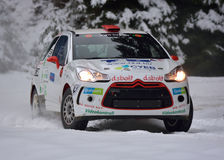 COVASNA, ROMANIA - January 16: Unknown pilots competing in Winter Rally Covasna 2016 on January 16, in Covasna, Romanaia. COVASNA, ROMANIA - January 16: Unknown Royalty Free Stock Photography